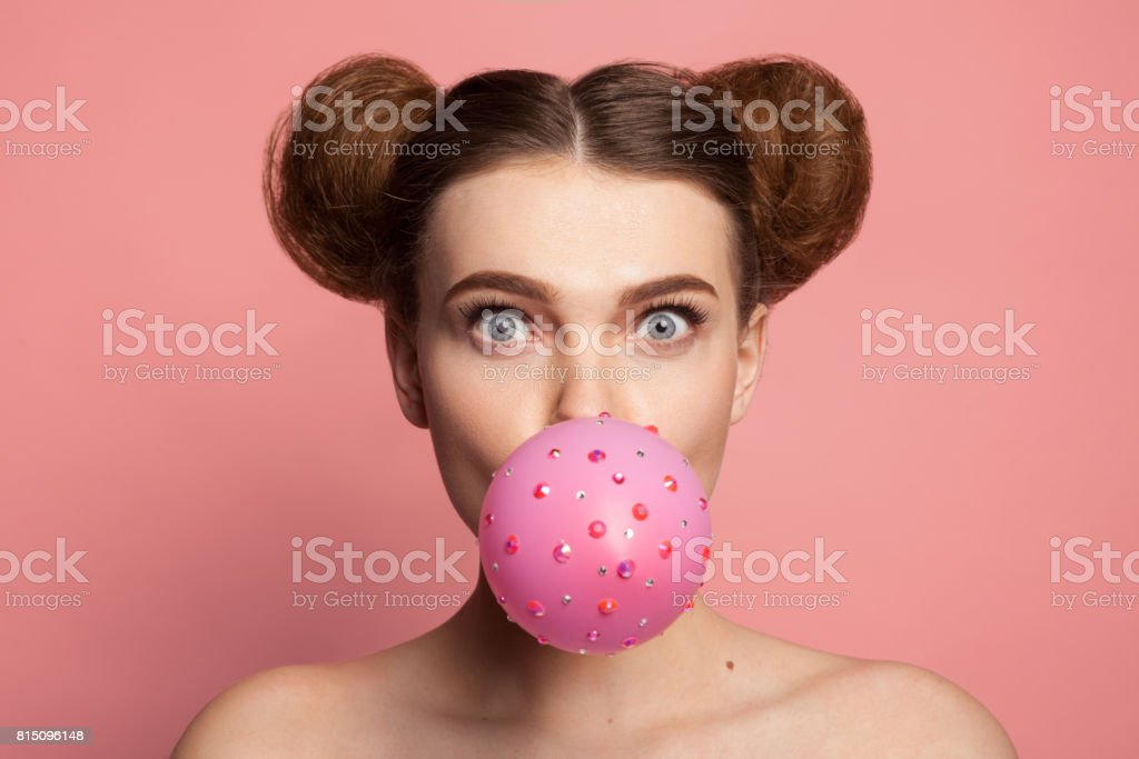 Girl blowing bubble gum stock photo