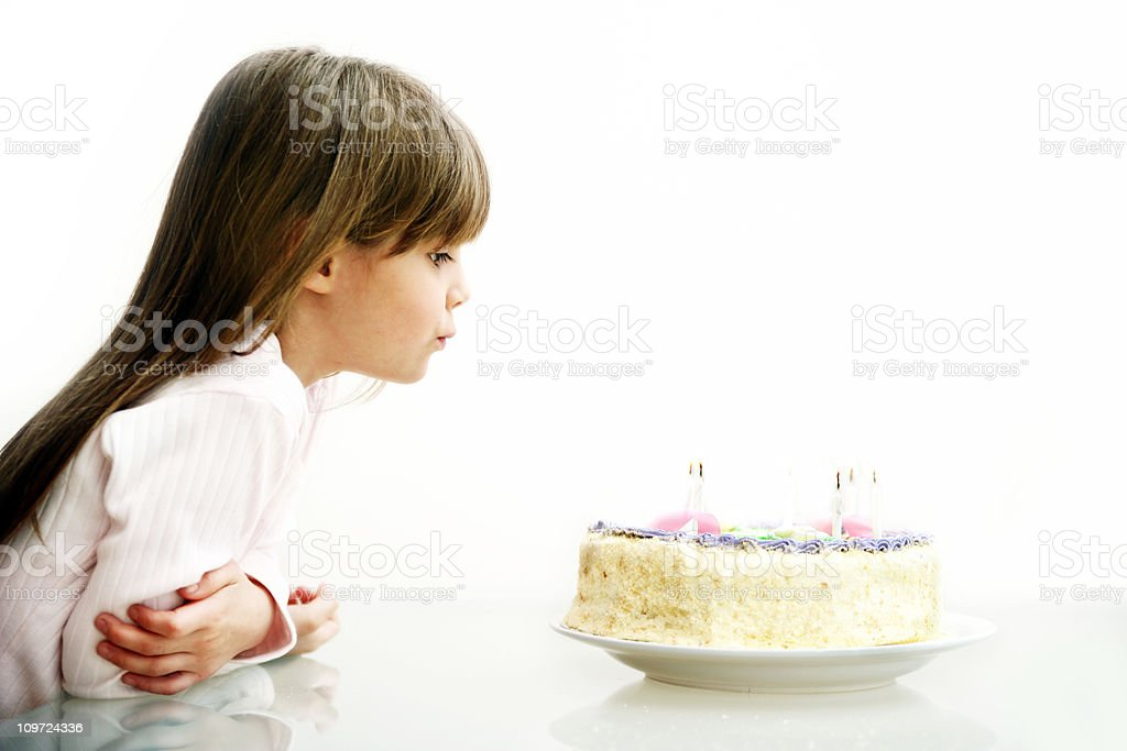 Girl blowing Candles stock photo