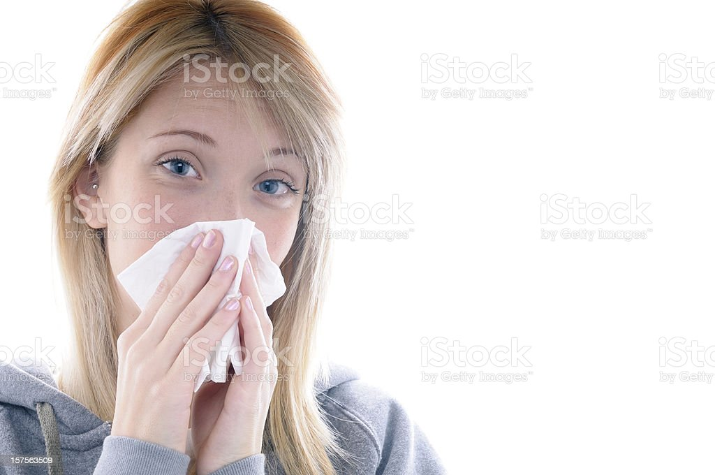 Girl Blowing her Nose.Copy Space stock photo