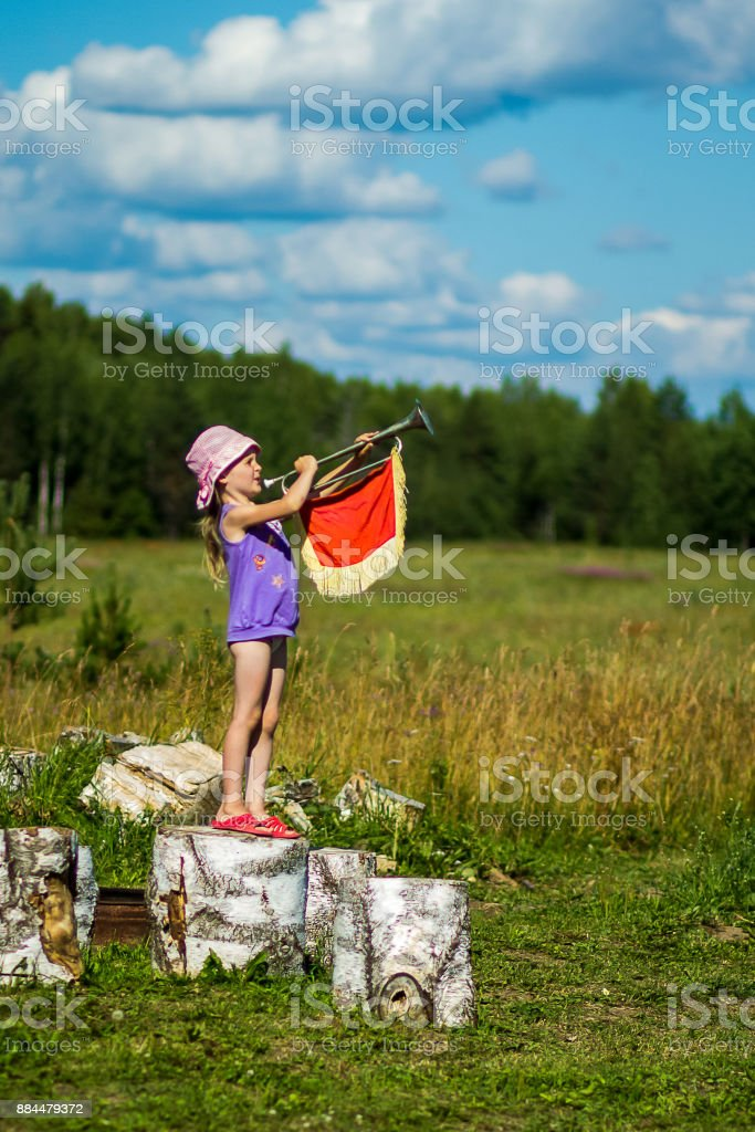 Girl blowing his horn stock photo