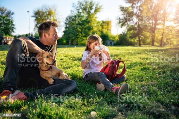 Girl blowing nose and sitting on grass with father picture id1004225238?b=1&k=6&m=1004225238&s=612x612&h=fwthpyfxzmsmoh0ybrdpeyugui4esxtp 8php8v9y3o=