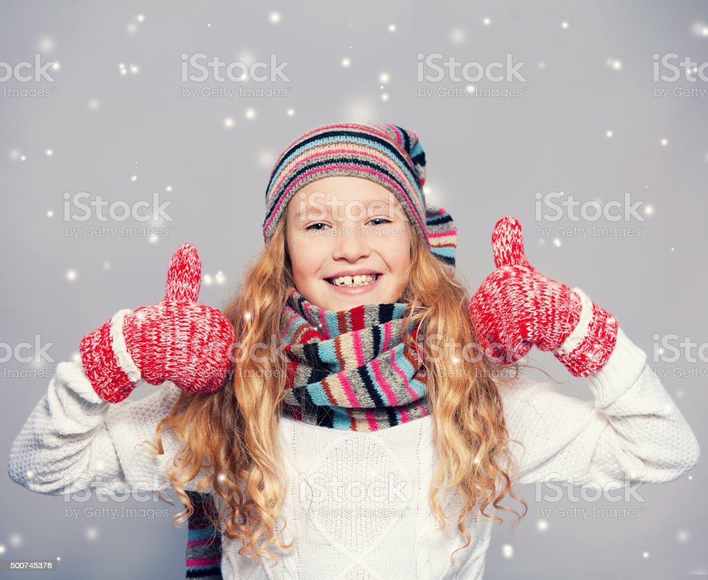Girl blowing on the snow stock photo