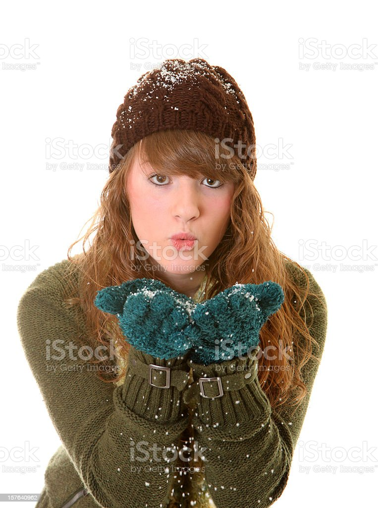girl blowing snow from hands royalty-free stock photo