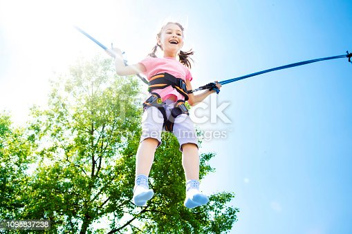 istock Girl Bouncing High 1095837238