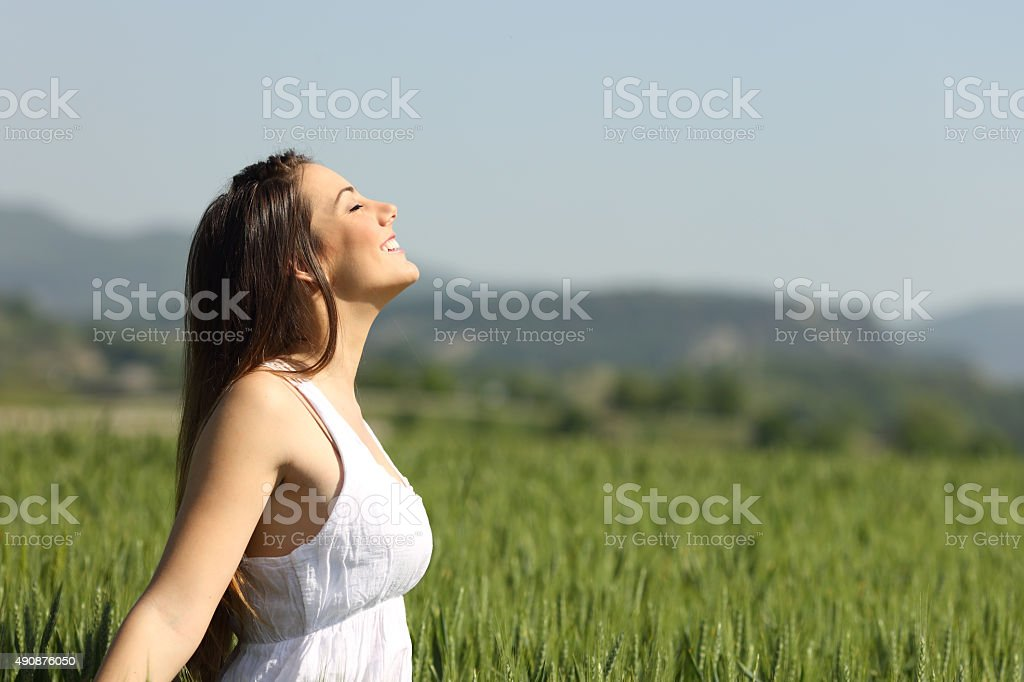 Girl breathing fresh air with white dress stock photo