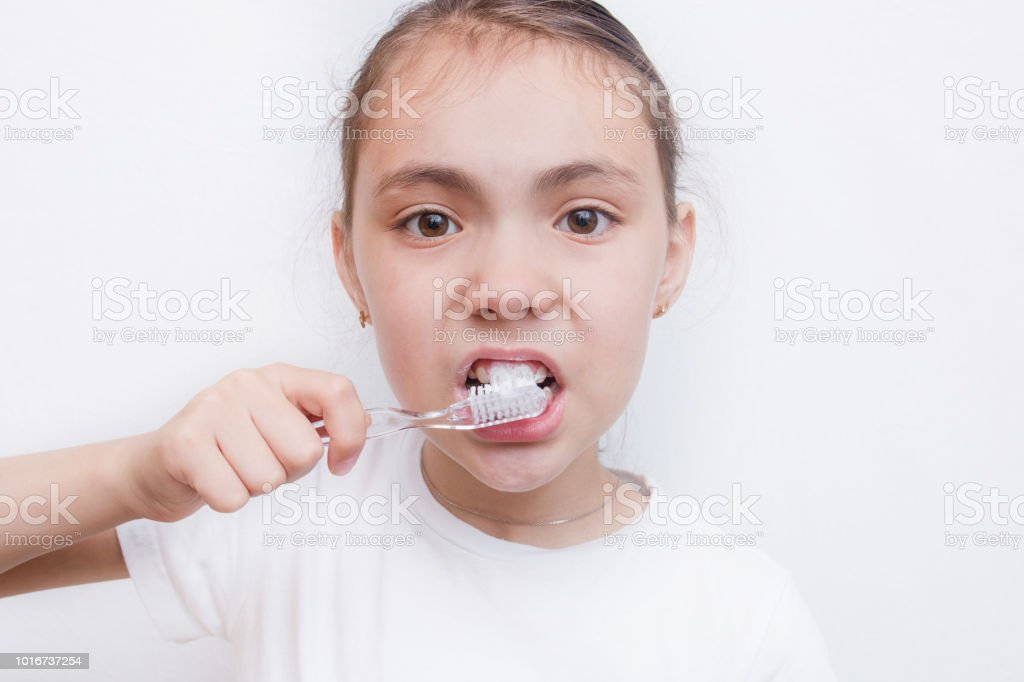 Girl brushing cleaning teeth. Girl with toothbrush. Oral hygiene, isolated stock photo