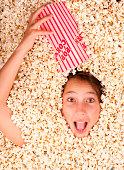 istock girl buried in popcorn 177528611