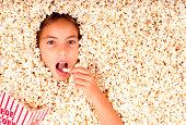istock girl buried in popcorn 177532827