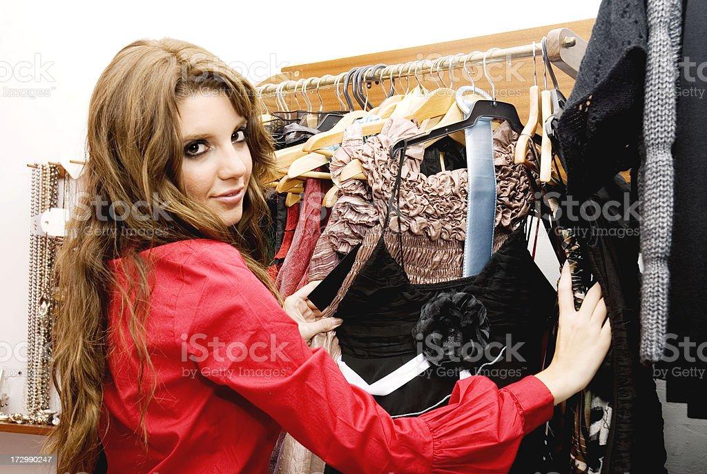 Girl buying at a dress shop royalty-free stock photo