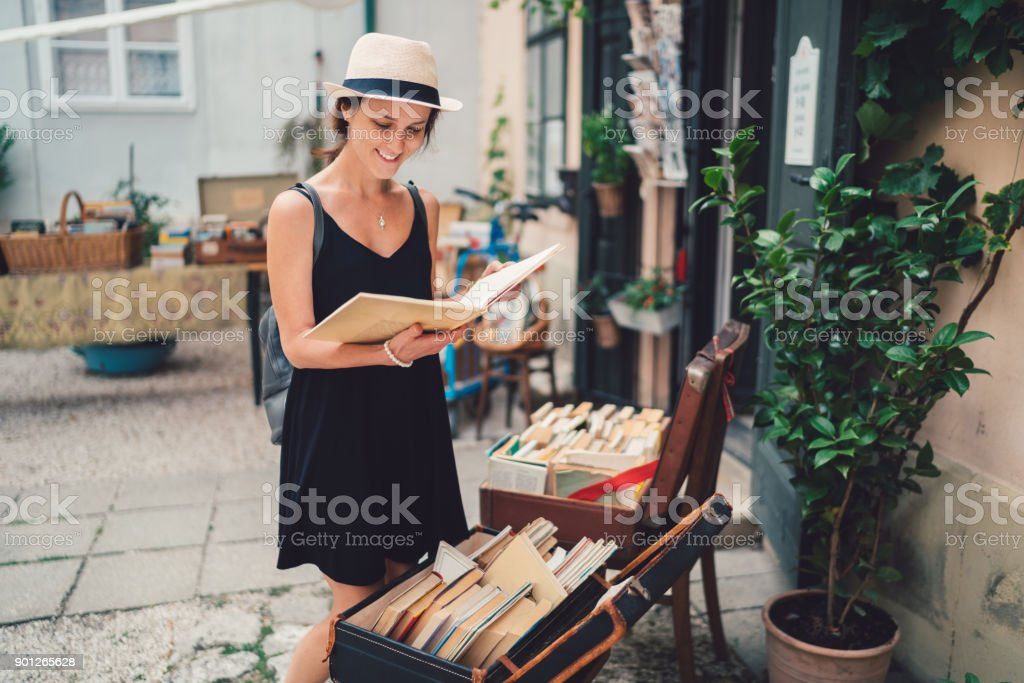 Girl buying books in Budapest
