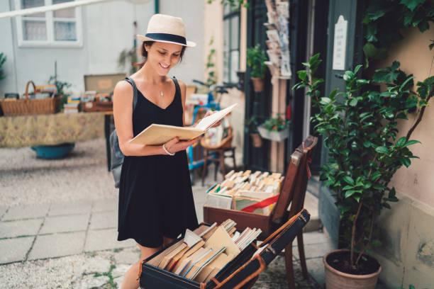 Girl buying books in budapest picture id901265628?b=1&k=6&m=901265628&s=612x612&w=0&h=kk8htqes2kuxiobbus0dhazttodyu2oiberbimxzahs=
