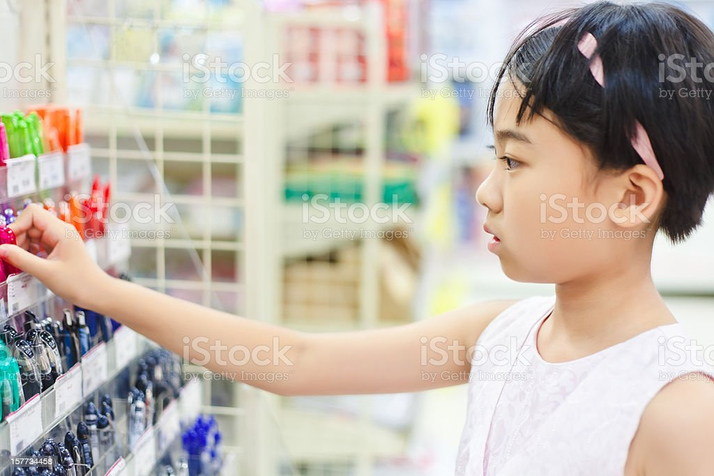 girl buying pen for study royalty-free stock photo