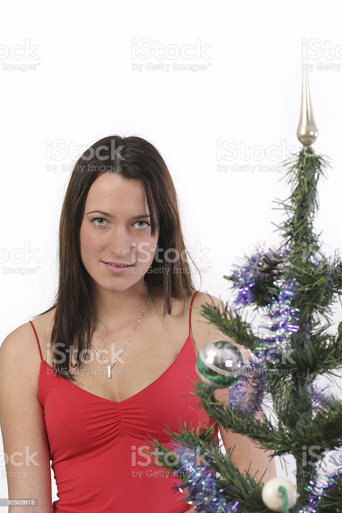 Girl by Christmas tree royalty-free stock photo