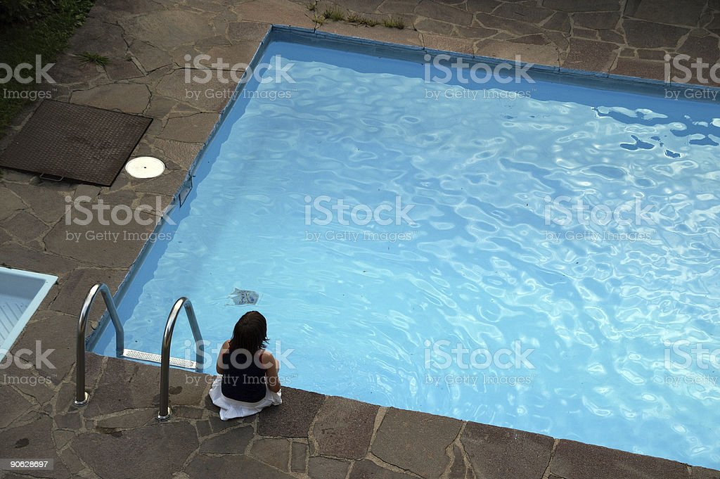 girl by pool royalty-free stock photo