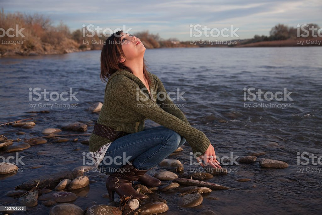 Girl by River stock photo