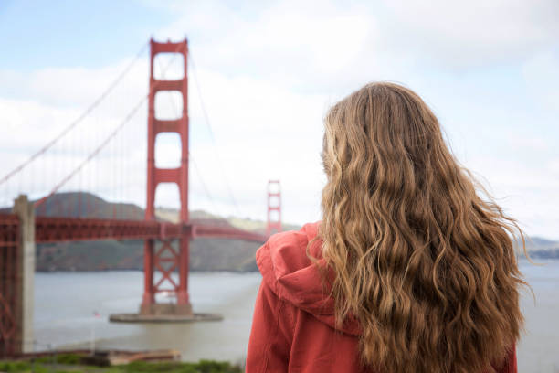 A girl by the Golden Gate Bridge A girl sight seeing jude beck stock pictures, royalty-free photos & images