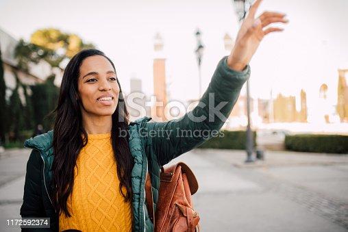 812419994 istock photo Girl calling a taxi 1172592374