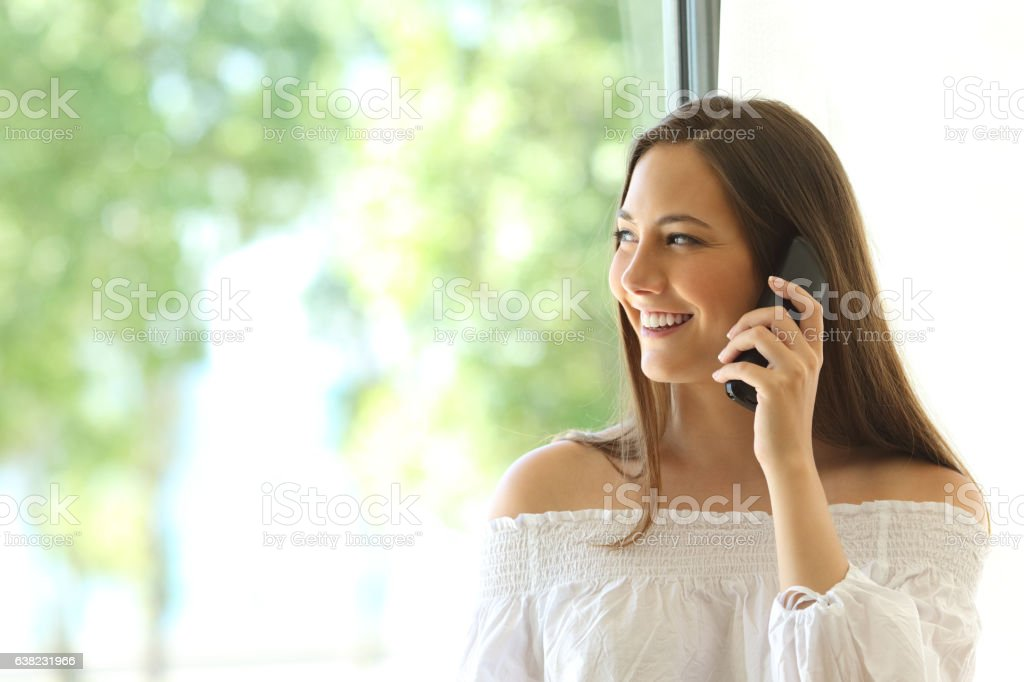 Girl calling on phone landline at home stock photo