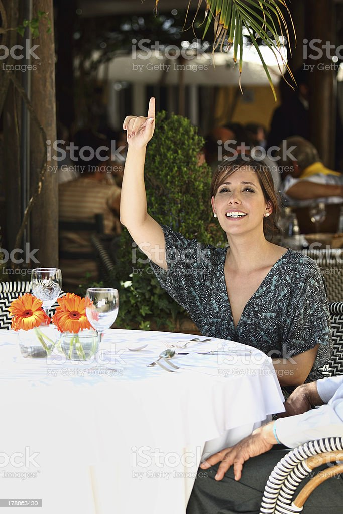 Girl calling the waitress stock photo
