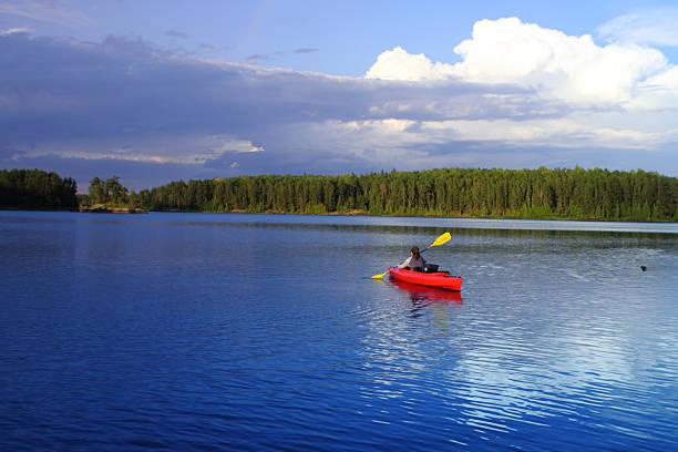 Girl canoeing stock photo