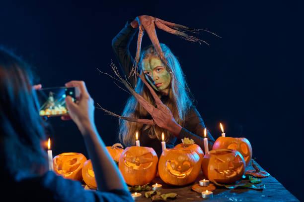 Girl capturing photo of halloween woman with her smart phone picture id852085622?b=1&k=6&m=852085622&s=612x612&w=0&h=zcpkeplrd2tsvshresohuu7wv4j6nre rx9gmsysu9u=