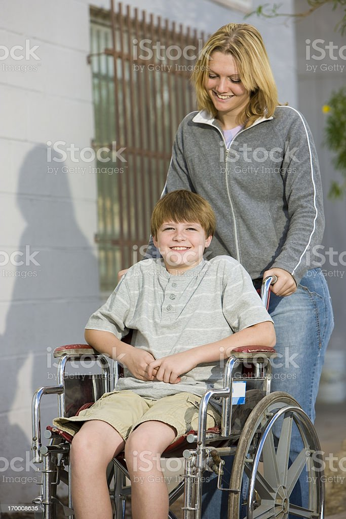 Girl Caring for Disabled Boy royalty-free stock photo