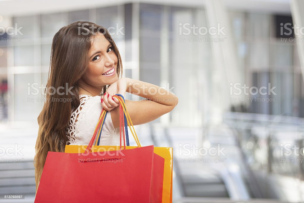 Girl carrying shopping bags stock photo