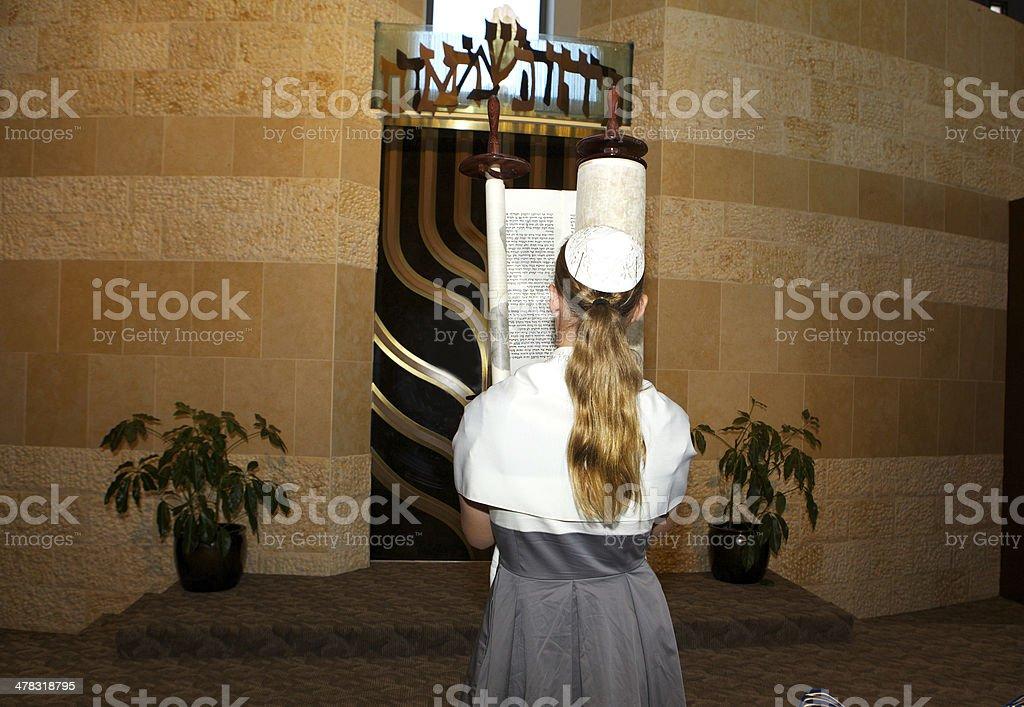 Girl Carrying the Torah During her Bat Mitzvah stock photo
