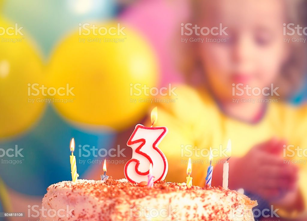 Girl Celebrating Birthday - 3 Years Old stock photo