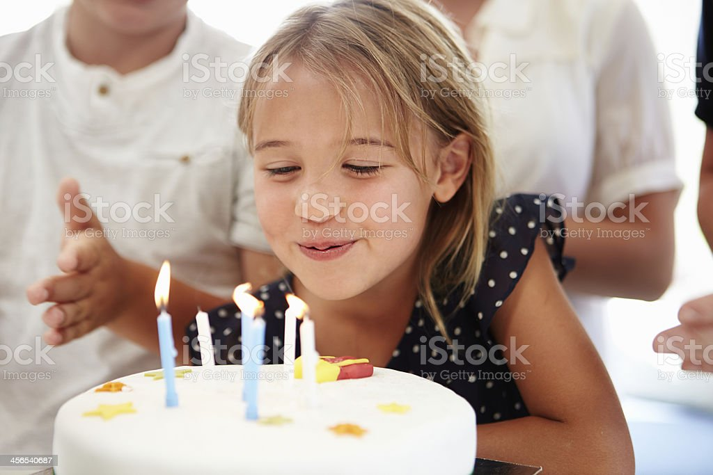 Girl Celebrating Birthday With Cake stock photo