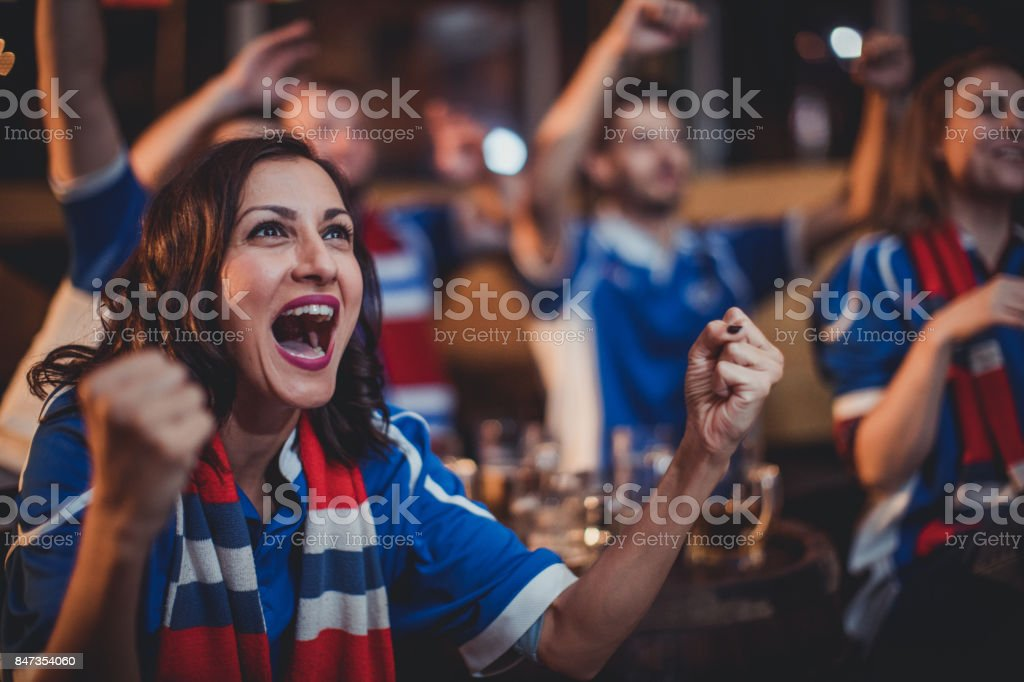 Girl celebrating with friends stock photo