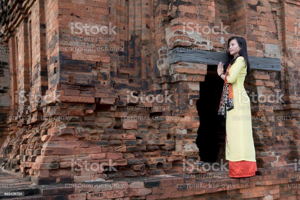Girl Champa standing beside ancient Po Klong Garai temple stock photo