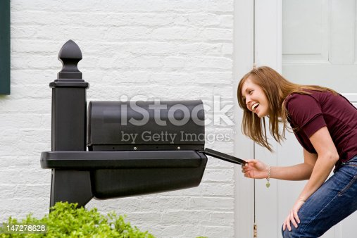 istock Girl Checking for Mail 147278628