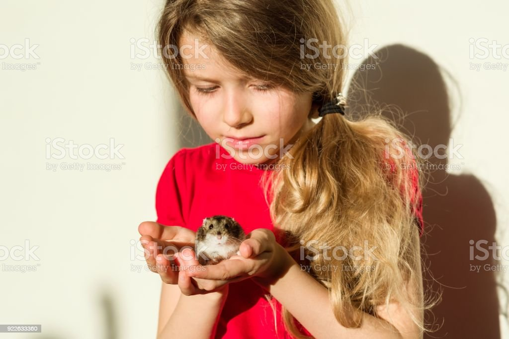 Girl Child 7 Years Old Blonde With Long Wavy Hair Holds In The Hands