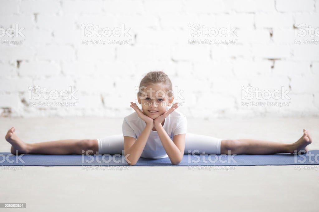 Girl child in Straight Angle pose, white studio background stock photo