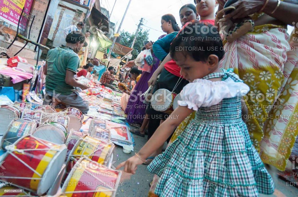 Girl child purchasing. stock photo