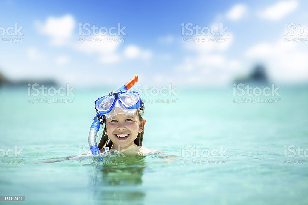 Girl child with snorkel stock photo