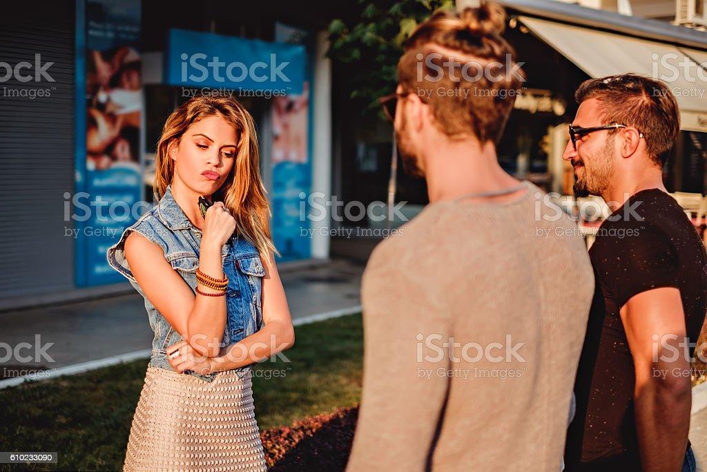 Girl choosing between two man stock photo