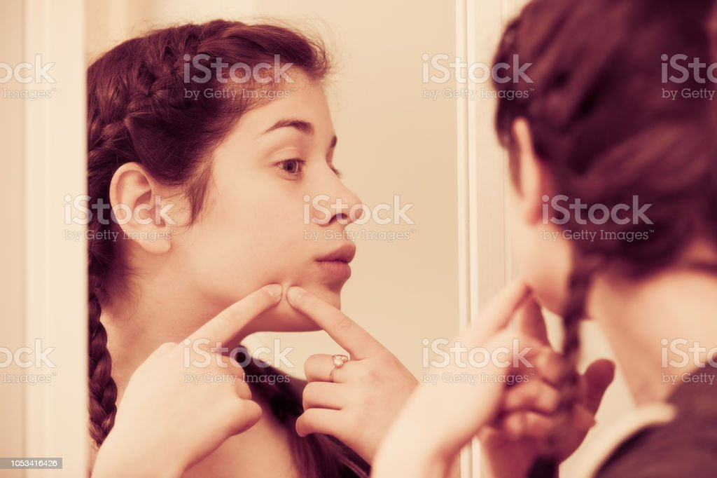 Girl cleaning pores stock photo