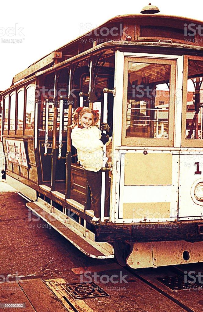 Girl climbed on a trolley-car stock photo