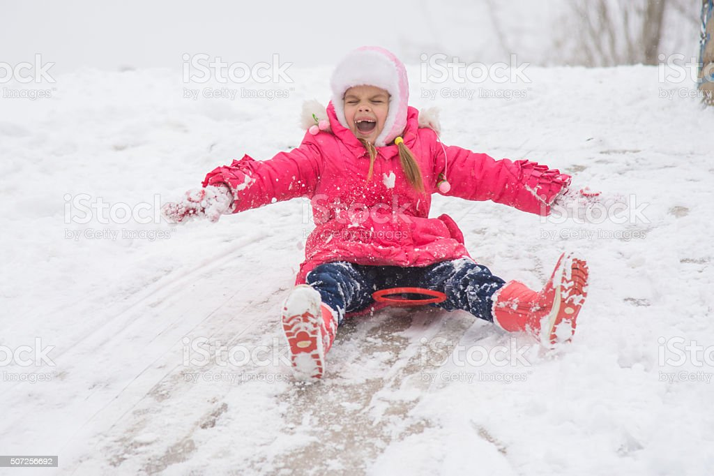 Girl closing her eyes and opening ice kind rolling hills stock photo