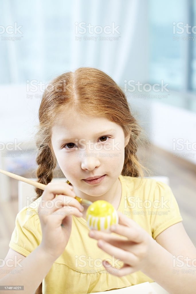 Girl coloring Easter egg royalty-free stock photo