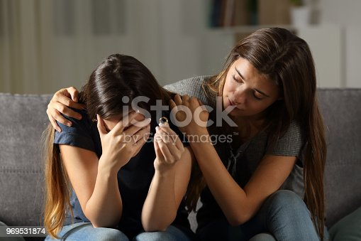 istock Girl comforting her divorced friend 969531874