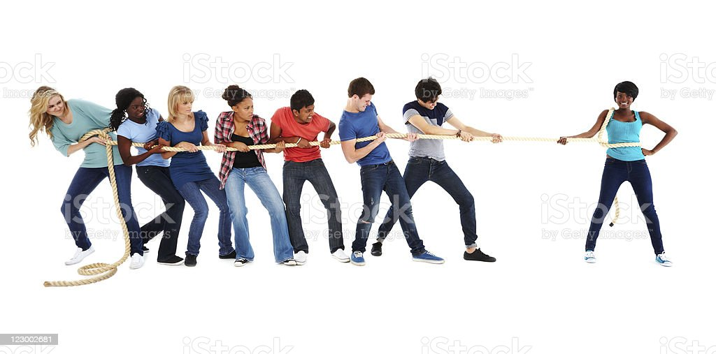 Girl Competing vs Group in Tug of War - Isolated royalty-free stock photo