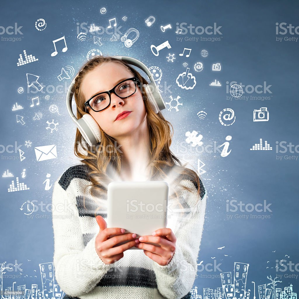Girl connected to internet with tablet. stock photo