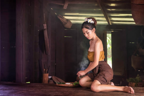 girl cooking in a Thai kitchen stock photo