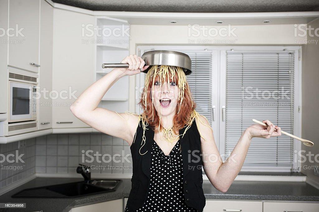 Girl cooking spaghetti stock photo