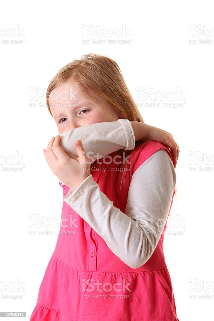girl coughing into arm royalty-free stock photo