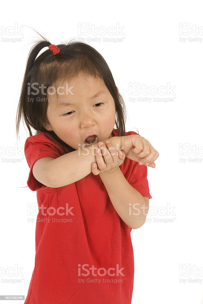Girl coughing into her arm royalty-free stock photo