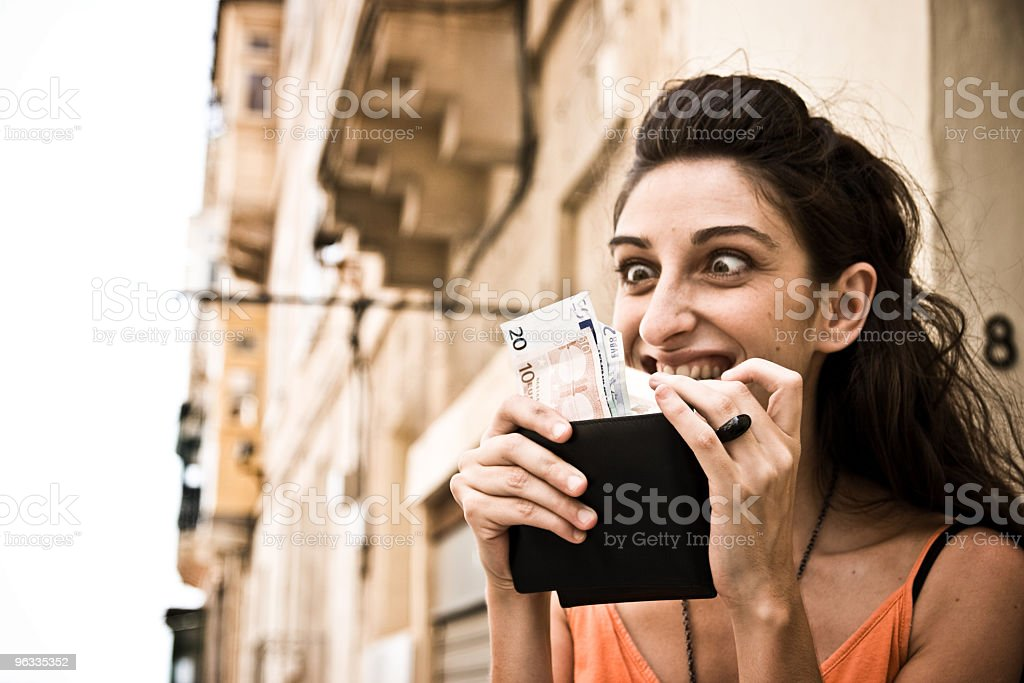 Girl counting Euros, Money addiction stock photo